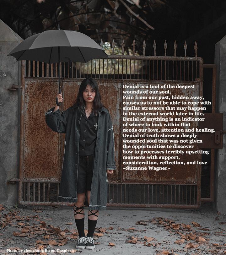 womanwithumbrellabygatequotesw